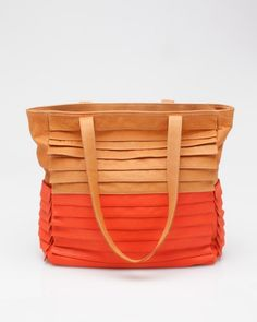 """Bottega in Apricot/Orange    Collina Strada    Large leather tote from Collina Strada, exclusive collaboration with Need Supply Co. Features layered leather front detail, color-block detailing, black nylon lining, two long drop handles, and two outer side pockets.    Made in USA    14"""" width  13"""" height  5"""" depth    12"""" handle drop"""