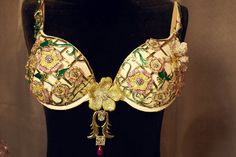 A floral garden full of amethysts, sapphires, rubies & diamonds in pink, white & yellow. This year's Fantasy Bra is a blingy little thingy.  Pic by Russell James.