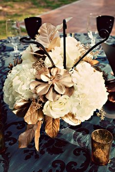 Breath taking! #wedding #events #centerpiece #flowers #bronze #metallic