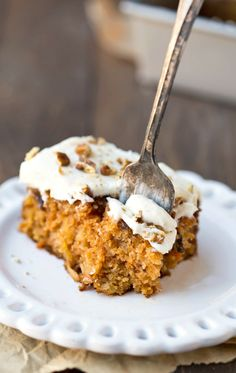 Blue Ribbon Carrot Sheet Cake is a moist carrot sheet cake recipe that's topped with both a buttermilk glaze and rich cream cheese frosting!