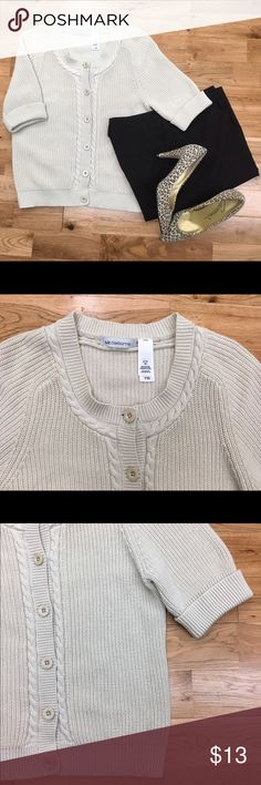 Liz Claiborne Short Sleeve Cardigan Oatmeal short sleeve cardigan by Liz Claiborne. This sweater features six button closures down the front and nice braided/ribbed detail. There are cuffed sleeves that come to the elbow. 100% cotton - machine wash/dry per tag. Great sweater when you just need a little extra warmth! Liz Claiborne Sweaters Cardigans