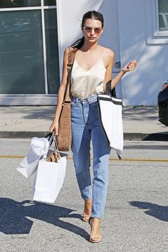 Emily Ratajkowski shows that a silk cami, mom jeans, and single-strap heels make the perfect daytime look