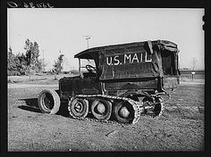 Once mail trucks started to become more common, though, certain modifications had to be made to accommodate vehicles for delivery in snowy weather. Here is a mail truck adapted to use extra wheels and special treads that was used in snowy Nevada County, California, in 1940, as photographed by Russell Lee.