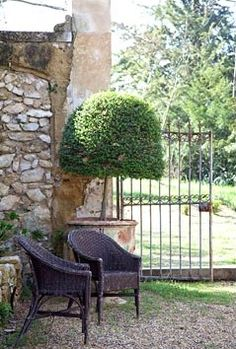2 wicker chairs to welcome the guests at on the front entrance (provence,France)