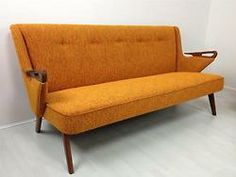 Vintage Orange Sofa & Loveseat  I like this chair because the colour and shape got my interest.