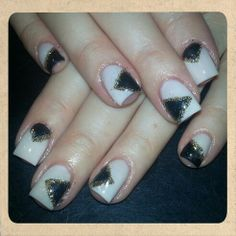 Chic black cream and gold new year's gel nail design triangle