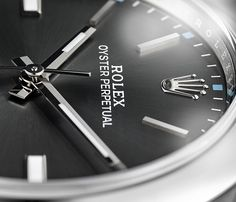 The dark rhodium dial of the Rolex Oyster Perpetual 39. Designed and manufactured in-house by Rolex, largely by hand, to ensure perfection.