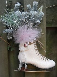 Ice skate turned Christmas planter decoration with winter greenery, pink tule, lace, and antique brooch ~ Lovely!