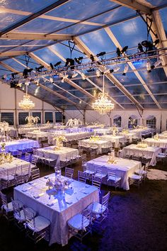 Indian wedding reception in a clear span tent. Crystal chandeliers by SignatureChandeliers.com #indianwedding #platinumwedding #cleartop #clearspan #tentwedding #signaturechandeliers