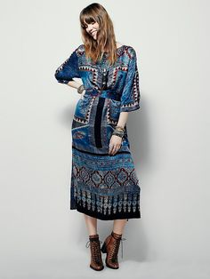 Artisan Indira Dress | Featured in a traditional Ajrakh sari pattern that has been re-imagined onto the perfect day-to-night maxi, this dress is made from handwoven silk.  With hip pockets and open slits down the thee-quarter length sleeves.  Lined.