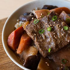 Galbi Jim is a Korean style Braised Short Rib stew. The short ribs are so juicy and tender. Served with root vegetables and rice.