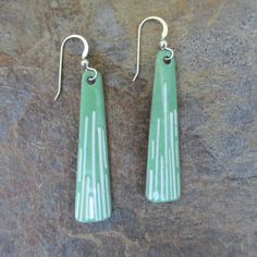 handmade green enamel earrings with white lines on a sterling
