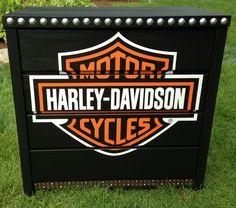 Harley-Davidson dresser using poster, old belt, and nailhead trim. Harley-Davidson of Long Branch www.hdlongbranch.com
