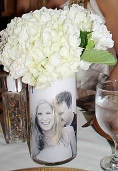 Incorporating photographs of the happy couple into your bridal shower centerpieces is a unique idea.  See more bridal shower decorations and party ideas at www.one-stop-party-ideas.com