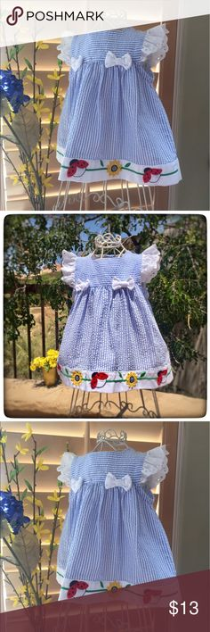 Vintage Little Bitty Seersucker Dress Vintage Little Bitty Seersucker Dress with with eyelet lace Flutter sleeves and matching eyelet lace bloomers. Imported Algondon  cotton poly blend , Made in Philippines style , quality and workmanship. Bow accents and ladybug and daisy appliqués . EVC . More quality vintage Baby on website link in profile. Vintage Matching Sets
