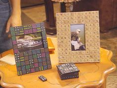 Hot glue is used to embellish plain picture frames with dominos and Scrabble pieces.