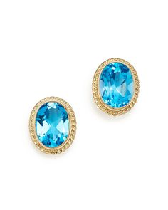 Blue Topaz Oval Medium Bezel Stud Earrings in 14K Yellow Gold