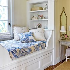 This boat-inspired sleeping nook, featured in Coastal Living, has built-in storage and a hidden trundle below for sleepover guests, maximizing limited space while displaying trinkets collected from travels. | Photo: Jonny Valiant | thisoldhouse.com