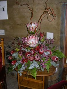 A real South African wedding with gorgeous proteas all the way and en masse