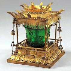 Sarira Reliquary. Unified Silla, 8th century h. = 15.9 cm (6.25 in) Daegu National Museum.  This reliquary was found inside the five-story pagoda at Songnimsa. It consists of a green glass bottle inside a green glass cup inside a gilt-bronze pavilion. The sarira were placed inside the bottle