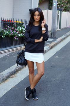 I would never think to wear wedge sneakers with a skirt but she makes it look good!