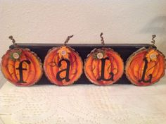 This wood block measures 12 long, 1 thick and has been painted black. Wooden Pumpkin Crafts, Wood Slice Crafts, Wooden Pumpkins, Wooden Crafts, Fall Pumpkins, Fall Crafts, Halloween Crafts, Holiday Crafts, Halloween Ideas