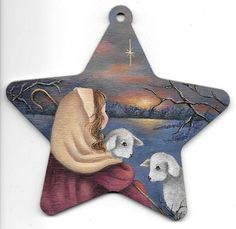 """Christmas Ornament E-Packet & Printed packet. """"The Little Shepherd Girl"""".A sweet little shepherd girl tending to her two adorable lambs. This packet is painted with DecoArt Acrylics on a 4 1/2"""" wooden star."""