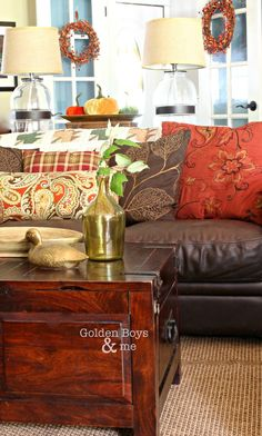 Crate and Barrel trunk style coffee table with brown leather sofa in fall family room-www.goldenboysandme.com