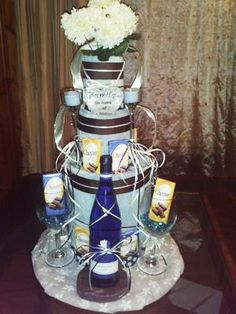 tiffany blue wedding towel cake with wine and glasses