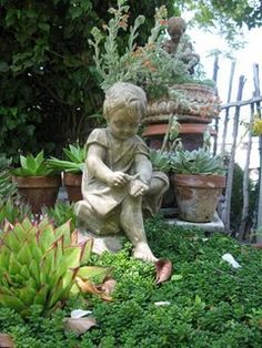 I love having statues in my garden.