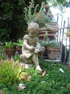I love statues in my garden