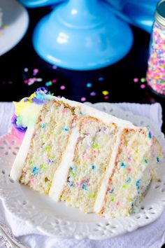 A light and fluffy white Funfetti cake made from scratch, speckled with sprinkles, and iced with a sweet buttercream frosting.
