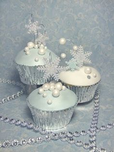 Close up of the cupcakes. This was designed for a bride that wanted a white christmas wedding. Snow flakes and snow balls are all made from fondant. Cupcakes are chocolate mud cake. Winter Cupcakes, Winter Wedding Cupcakes, Love Cupcakes, Christmas Cupcakes, Christmas Desserts, Christmas Baking, Themed Cupcakes, Pearl Cupcakes, Wedding Cake