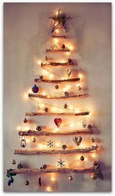 Alternative Christmas tree! Use 25 Candle Impressions flameless votives rather than Christmas lights to turn this tree into an Advent Calender. Light a candle every night until the tree is lit!  Don't forget to use the timer option-- when the candle turns on, it's time to light the next.