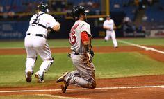 Dustin Pedroia Photos Photos - Dustin Pedroia #15 of the Boston Red Sox slides…