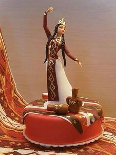 Armenian dancing girl cake--- how cute! I duno why I love the braids.