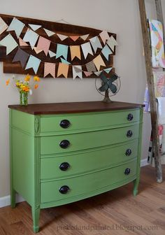"""Painted with Moss Point Green satin by Olympic One (found at Lowe's). Top stained with Minwax Dark Walnut. Distressed the legs and lightly along the edges to make the grooves in the legs """"pop"""". The whole piece is protected with wax. Original pulls spray painted with Oil Rubbed Bronze."""