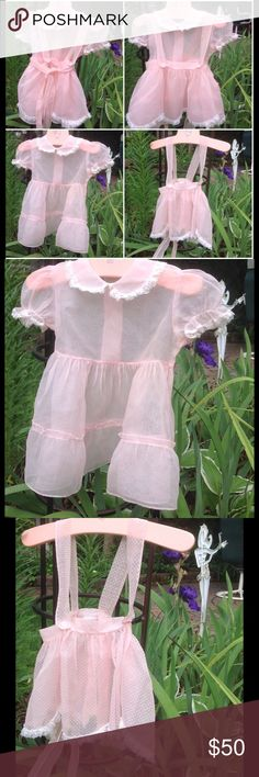 Girls Pink Pinafore dress This two piece girls dress is made from a sheer pink organza and the pinafore is a dotted Swiss. This dress was handmade for me by my mom. Excellent shape for being over 50 years ago. I'm not sure of the size. Possibly a 2. I can post more measurements if interested. Dresses