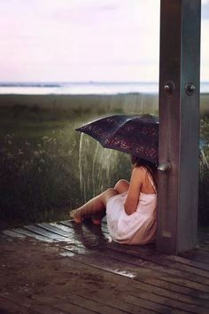 ˚I choose to think that she has chosen to sit in the rain with an umbrella, to be alone for awhile.