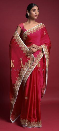 Apple red saree in satin blend with ice blue border. Adorned with zari and sequins embroidered border. Further enhanced with embroidered buttis. Bridal Sarees, Wedding Sarees, Red Saree, Sari, Indian Fashion, Women's Fashion, Blouse Online, Red Apple, Blue Blouse
