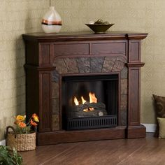 This cozy espresso electric fireplace is the ideal solution for staying warm while conserving energy on a cool evening. The sleek columns, crown molding, and rich dark finish of this fireplace will easily complement the look of any room of your home.