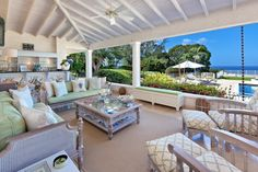 High Breeze on Barbados has a gorgeous balcony with elegant furniture and an ocean view.
