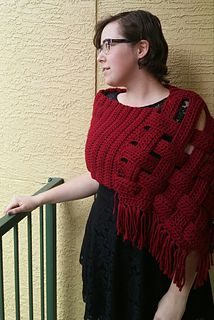 This Woven Lattice Shawl is made with super bulky and soft, yarn to keep you fashionably warm all winter long.