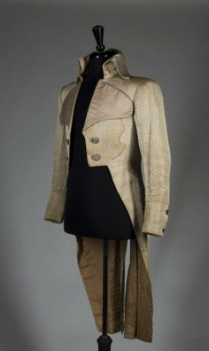 """A beige silk tail coat made for Anthony Bushell as Sir Andrew Foulkes in the 1934 film The Scarlet Pimpernel (United Artists), not seen on screen. Label inside marked """"B.J. Simmons & Co.,/ King St./ Covent Garden"""" and inscribed """"Bushell/ Pimpernel."""""""