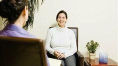 Two women talking in a clinic