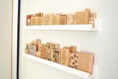 store and organize wood rubber stamps behind the narrow space of your office door