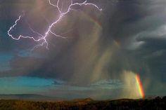 Rainbow meets lightning, in Sedona Arizona.