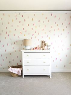 Paint brush wall decals placed in a pattern on a beige wall behind a white dresser. Each wall decal features a different shade of pink, orange, corals, etc. Vinyl Wall Stickers, Girl Wall Decals, Wall Vinyl, Girls Wall Stickers, Wall Décor, Wall Art, Paint Strokes, Beige Walls, Little Girl Rooms