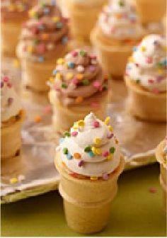 Mini Ice Cream Cone Cupcakes -- In this delicious dessert recipe, adorable cupcakes are baked into mini ice cream cones--perfectly scrumptious and guaranteed to bring out the kid in your guests.