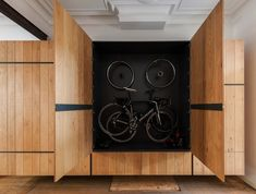 Dede gear closet by Belgium-based interior designers Van Staeyen is created to hang up bikes without clutter interior of house.